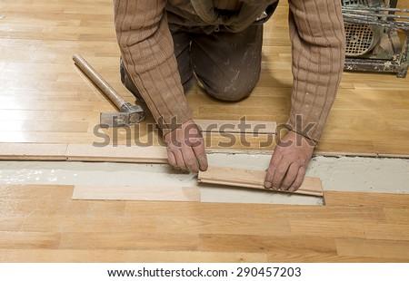 Fixing Wooden Floor - stock photo