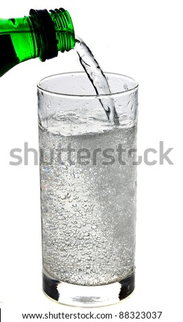 Fizzy drink poured into a glass isolated on white background - stock photo