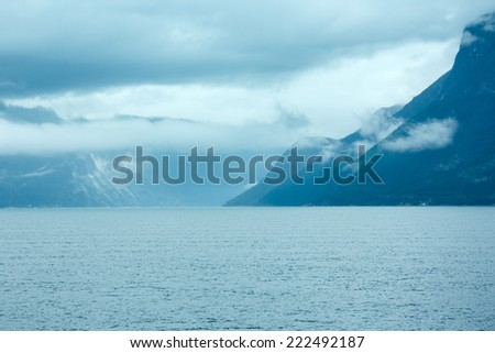 Fjord summer cloudy view from ferry (Norway) - stock photo