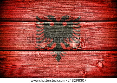 flag of Albania painted on old grungy wooden  background - stock photo