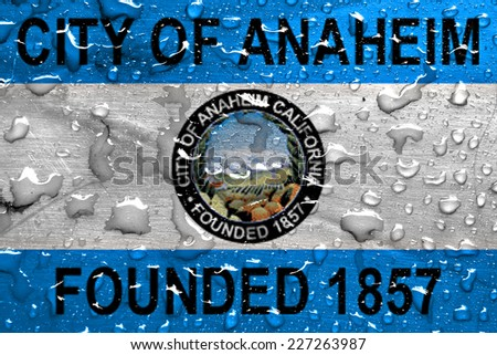 flag of Anaheim with rain drops - stock photo