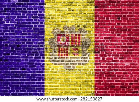 Flag of Andorra painted on brick wall, background texture - stock photo