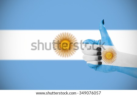 Flag of Argentina on female's hand, second, defocused flag in background. - stock photo