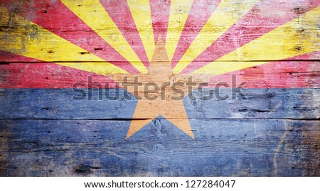 Flag of Arizona painted on grungy wooden background - stock photo