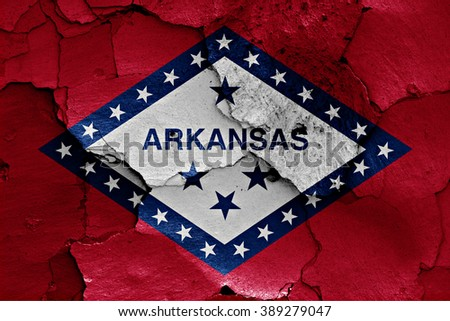 flag of Arkansas painted on cracked wall - stock photo