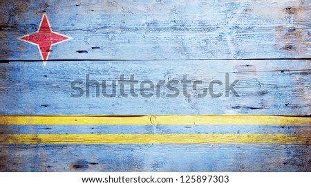 Flag of Aruba painted on grungy wood plank background - stock photo