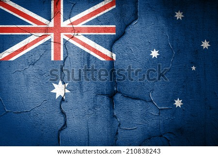 flag of Australia painted on cracked wall - stock photo