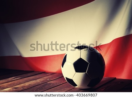 Flag of Austria with football on wooden boards as the background. Vintage Style. MANY OTHER PHOTOS FROM THIS SERIES IN MY PORTFOLIO. - stock photo