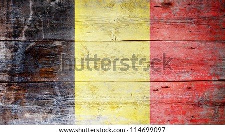 Flag of Belgium painted on grungy wood plank background - stock photo