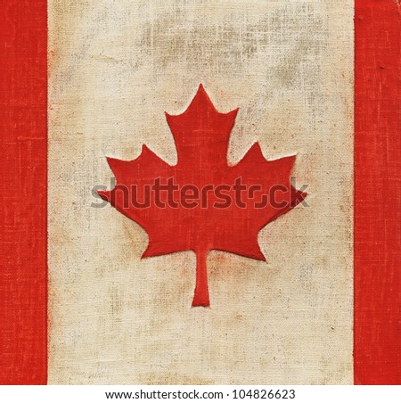 Flag of Canada painted on fabric - stock photo