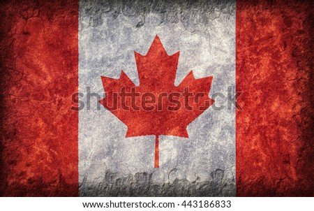 Flag of Canada painted onto a rough wall - stock photo