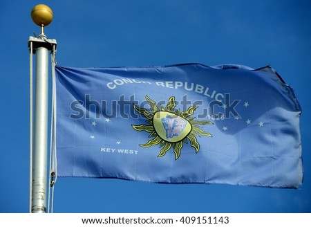 Flag of Conch Republic in blue sky background. Conch Republic was a nation declared by the city of Key West, Florida in 1982 for tourism purpose.  - stock photo