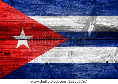 flag of Cuba or Cuban banner on wooden background - stock photo