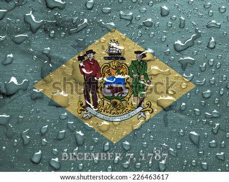 flag of Delaware with rain drops - stock photo