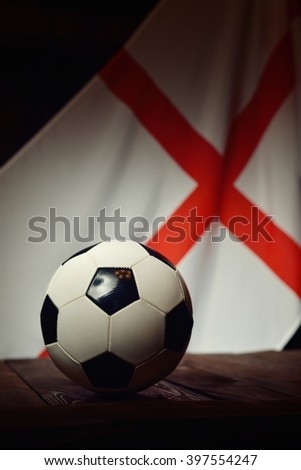 Flag of England with football on wooden boards as the background. MANY OTHER PHOTOS FROM THIS SERIES IN MY PORTFOLIO. - stock photo