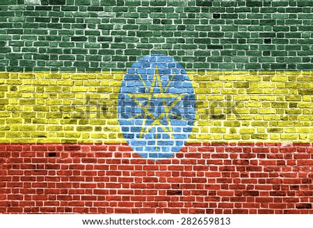 Flag of Ethiopia painted on brick wall, background texture  - stock photo