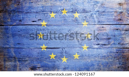 Flag of Europe painted on grungy wood plank background - stock photo