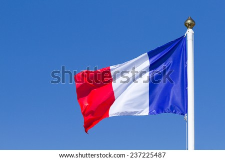 Flag of France on the blue sky - stock photo