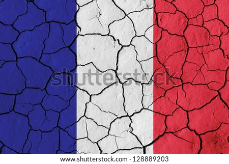 Flag of France over cracked background, conceptual image of crisis - stock photo