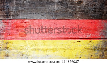Flag of Germany painted on grungy wood plank background - stock photo