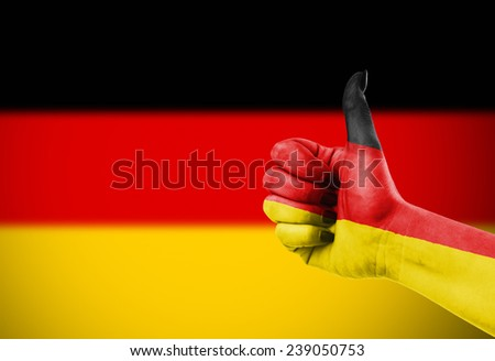 Flag of Germany painted on hand - stock photo