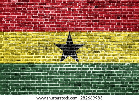Flag of Ghana painted on brick wall, background texture  - stock photo