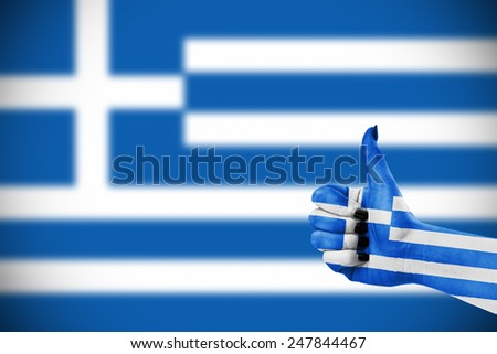 Flag of Greece on female's hand - stock photo