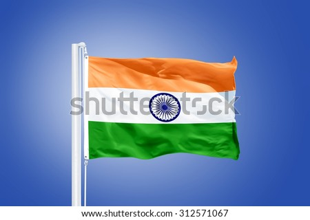 Flag of India flying against a blue sky. - stock photo