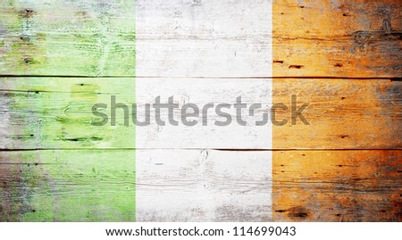 Flag of Ireland painted on grungy wood plank background - stock photo