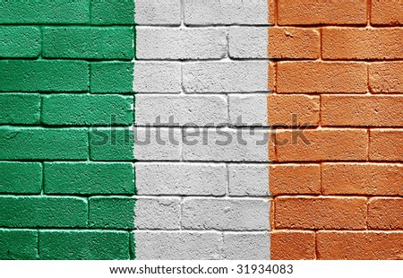 Flag of Ireland painted onto a grunge brick wall - stock photo