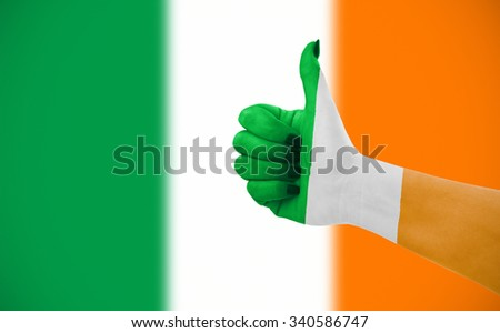 Flag of Irelandon female's hand, second, defocused flag in background. - stock photo