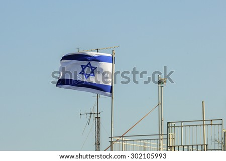 Flag of Israel waving in the wind in Jerusalem - stock photo