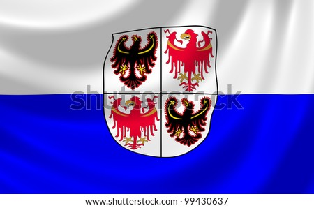 Flag of Italian Trentino Alto ; South Tyrol region waving in the wind detail - stock photo