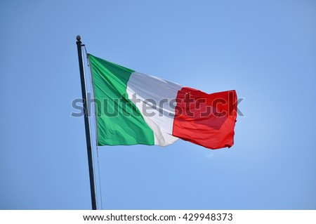 Flag of Italy blowing in the wind - stock photo