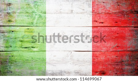 Flag of Italy painted on grungy wood plank background - stock photo