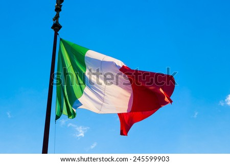 Flag of Italy, waving in the wind, on the sky - stock photo