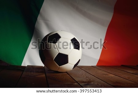 Flag of Italy with football on wooden boards as the background. MANY OTHER PHOTOS FROM THIS SERIES IN MY PORTFOLIO. - stock photo
