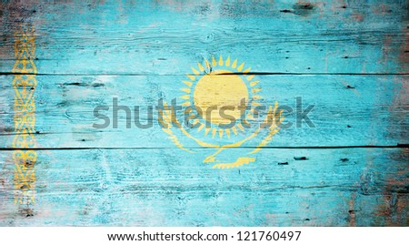 Flag of Kazakhstan painted on grungy wood plank background - stock photo