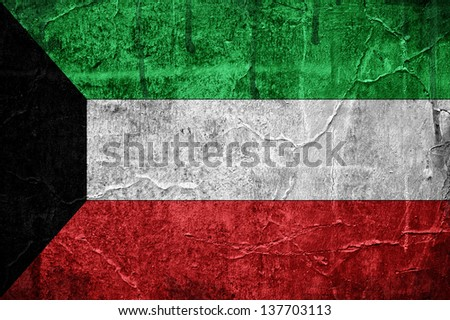 Flag of Kuwait, image is overlaid with grunge texture - stock photo