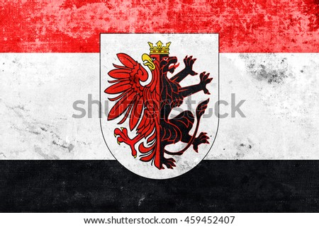 Flag of Kuyavian-Pomeranian Voivodeship with Coat of Arms, Poland, with a vintage and old look - stock photo