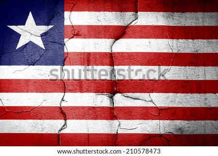 flag of Liberia painted on cracked wall - stock photo