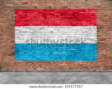 Flag of Luxembourg painted on brick wall - stock photo