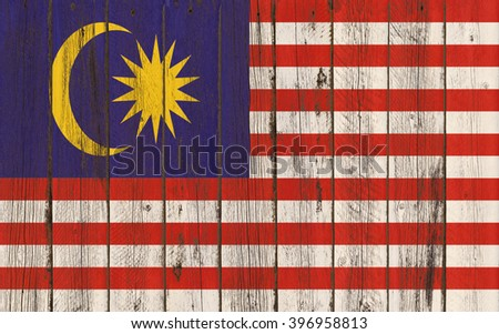 Flag of Malaysia painted on wooden frame - stock photo