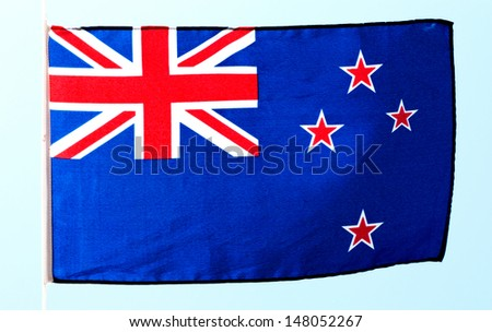 Flag of New Zealand against the sky - stock photo