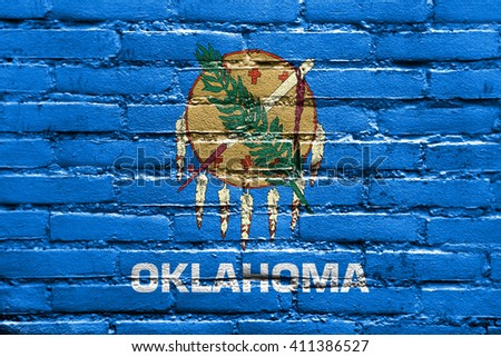 Flag of Oklahoma State, painted on brick wall - stock photo