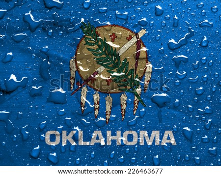 flag of Oklahoma with rain drops - stock photo