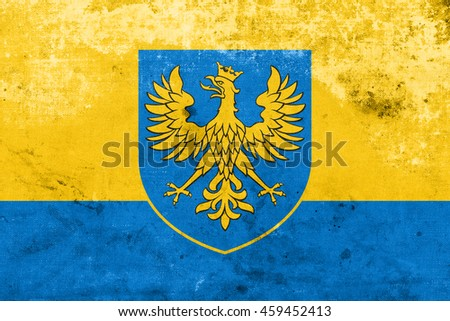 Flag of Opole Voivodeship with Coat of Arms, Poland, with a vintage and old look - stock photo