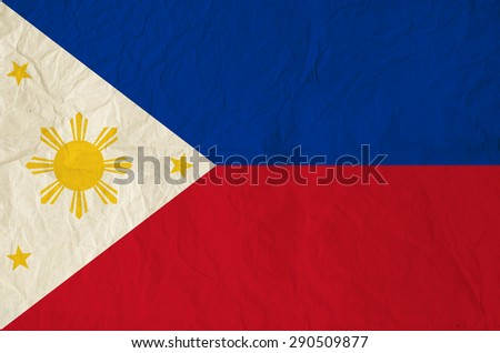 Flag of Philippines with vintage old paper - Pambansang Watawat - stock photo