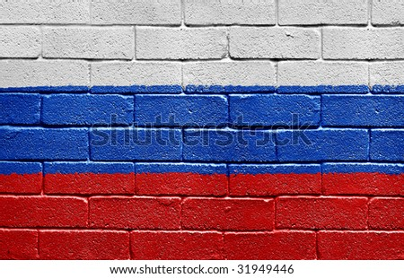 Flag of Russia painted onto a grunge brick wall - stock photo