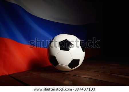 Flag of Russia with football on wooden boards as the background. MANY OTHER PHOTOS FROM THIS SERIES IN MY PORTFOLIO. - stock photo